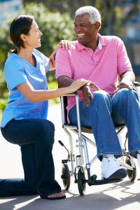 Female caregiver with male senior patient